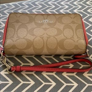 COACH PHONE AND WRISTLET— NEVER USED